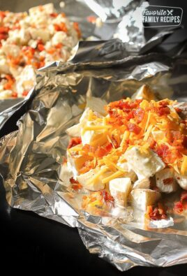 Grilled Foil Ranch Potatoes topped with bacon and cheese.