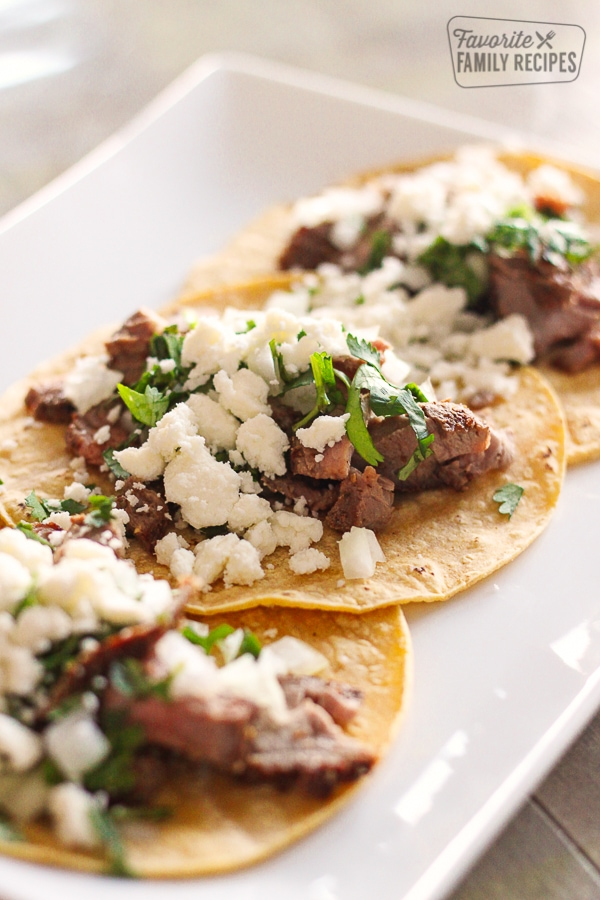 Close up of 3 Grilled Steak Street Tacos on a white tray.