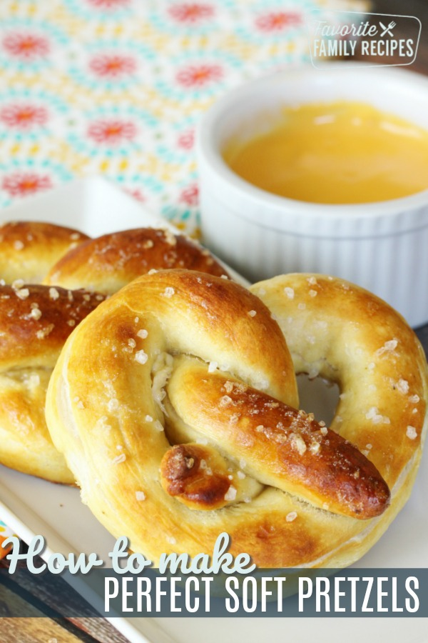 Homemade soft pretzels are a super easy snack or appetizer. You will love the buttery soft texture! Dip in cheese sauce, mustard, or honey mustard. #softpretzels #pretzel #pretzels #pretzelrecipe #cheesesauce #snack #appetizer #kidslunch #lunchbox #schoollunch #bread #saltysnack #homemadepretzels #lunch #partyfood #superbowl #gameday #favoritefamilyrecipes