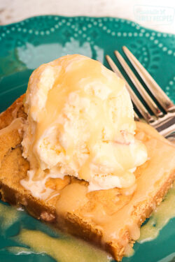 Applebee's Maple Butter Blondies Copycat square with a scoop of vanilla ice cream on top.