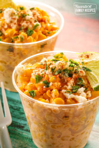 Mexican Street Corn in clear cups on a table