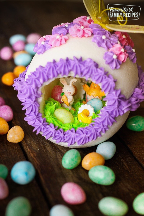 Panoramic Easter Eggs - a sugar egg decorated with frosting with miniature bunnies, chicks, flowers, and jelly beans in the center