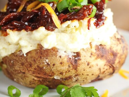 BBQ Beef Twice Baked Potato on a white plate.