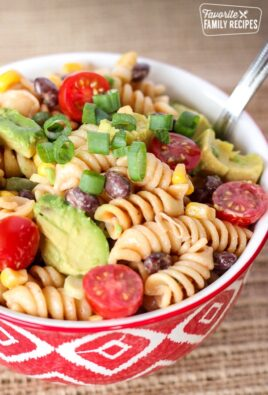 BBQ Ranch Pasta Salad in a red bowl with a silver spoon.
