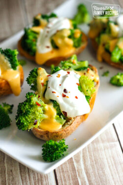 Broccoli Cheese Stuffed Potato Skins on a white plate.