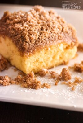 A slice of Cake Mix Coffee Cake on a white plate.
