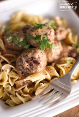 Easy Meatball Stroganoff in a bowl with a fork on the side.