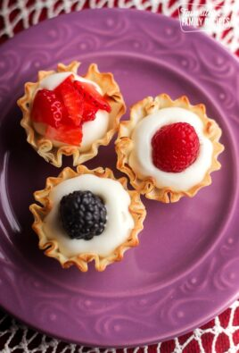 Overhead view of 3 Easy Phyllo Fruit Cups on a purple plate.
