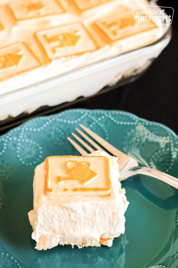 slice of four layer banana cream dessert on a plate