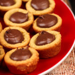 Peanut Butter Fudge Puddle cookies on a red plate.