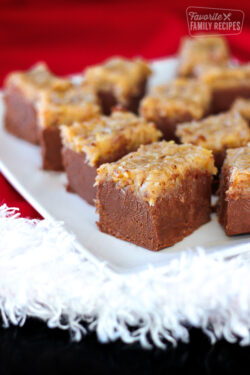 Pieces of German Chocolate Fudge on a Christmas tablecloth