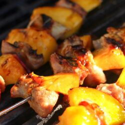 3 Honey Mustard Nectarine Pork Kabobs on a grill