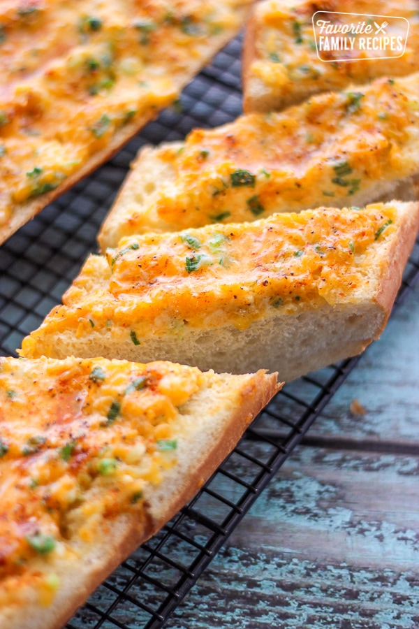 Hot Cheese Bread Slices on a cooling rack.