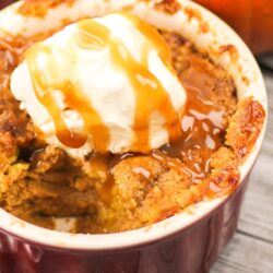 Pumpkin Cobbler Dessert in a dish with ice cream and caramel on top