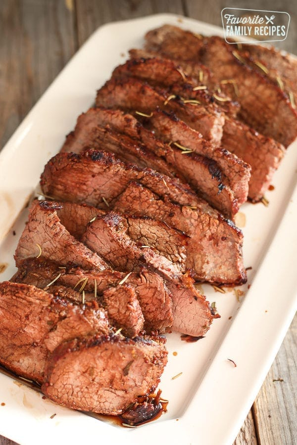 Thin Sliced Rosemary Tri Tip on a Serving Plate