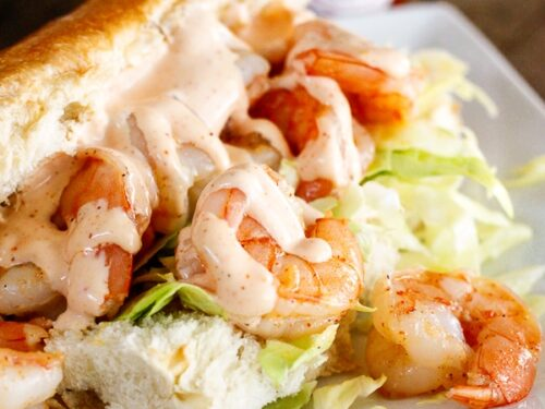 Shrimp po boy sandwich with creamy cajun sauce on a hoagie bun with shredded cabbage