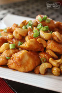 Cashew chicken on a white plate
