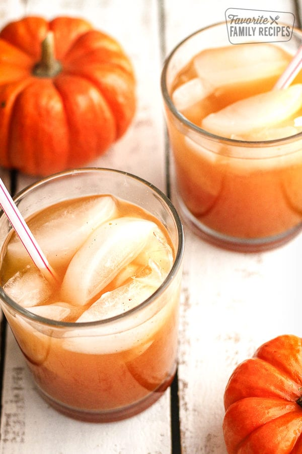 Pumpkin juice in glass cups with pumpkins on the side
