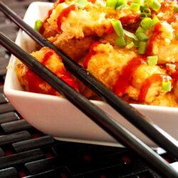 Bonefish Grill's Bang Bang Shrimp in a white bowl with black chopsticks