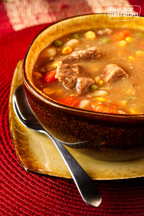 Hearty Beef Stew in a Bowl with a spoon on the side.