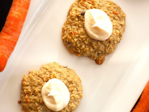 View from above of 4 Carrot Cake Cookies with Cream Cheese Frosting on a white tray.
