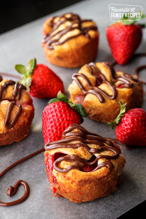 Chocolate covered Strawberry Tarts on parchment paper.