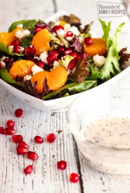 Christmas Salad in a bowl with a side of Poppyseed Dressing