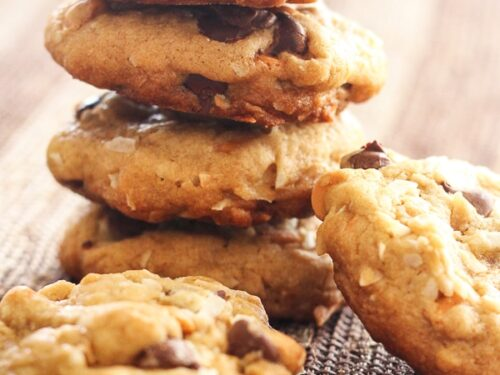 Coconut Butterscotch Chocolate Chip Cookies stacked on top of each other.