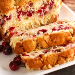 Sliced Cranberry Almond Bread on a plate