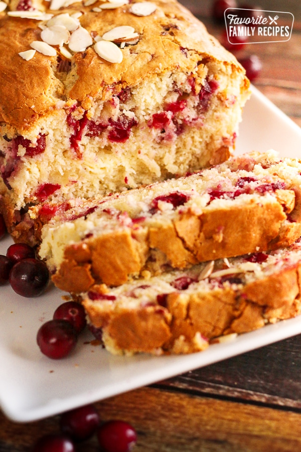 Sliced Cranberry Almond Bread on a white plate