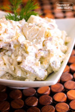 Bacon Gorgonzola Potato Salad in a white bowl.