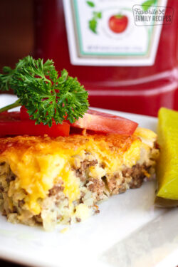 Easy Cheeseburger Pie topped with tomatoes and a garnish