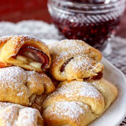 Easy Monte Cristos on a plate with a side of raspberry preserves