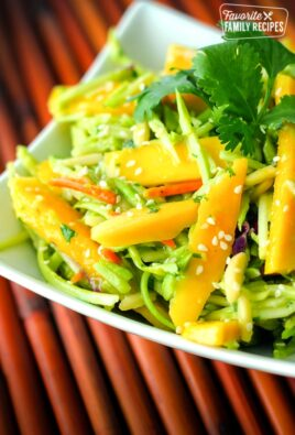Fresh Mango Avocado Coleslaw topped with a garnish in a white bowl.