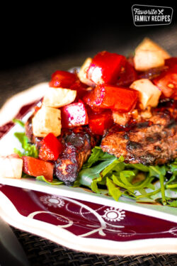 Close up of Grilled Balsamic Chicken with a chilled Bruschetta Topping on a plate.