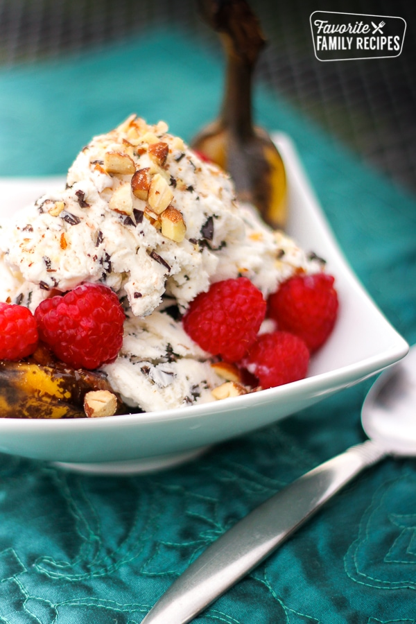 Grilled Banana Split Boats topped with ice cream and raspberries.