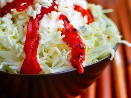 Red Pepper Coleslaw in a black bowl.