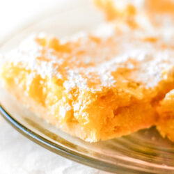 Close up of Lemon Square Bars on a clear plate