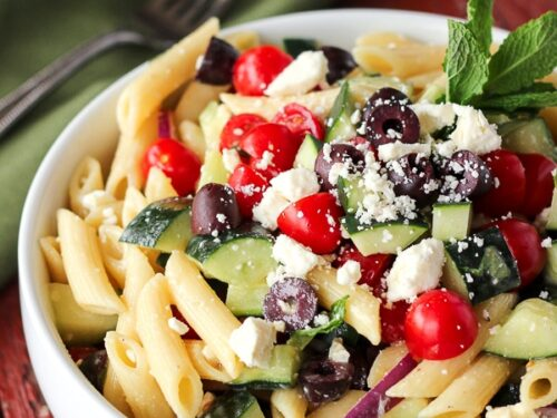 Light Greek Pasta Salad in a white Bowl with a fork on the side.