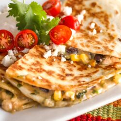 Low-Cal Veggie Quesadillas topped with tomatoes, cilantro, and feta cheese.
