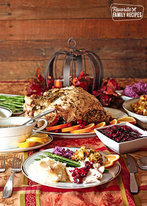 A low calorie Thanksgiving Dinner with turkey, gravy, cranberry sauce and stuffing on a decorated tablecloth