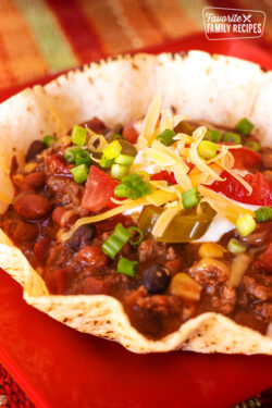 Mexican Chili topped with cheese and green onions in a Tostada Bowl