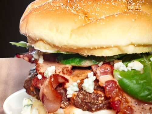 Bacon & Blue Cheese Burgers with Creamy Buffalo Sauce on a white plate