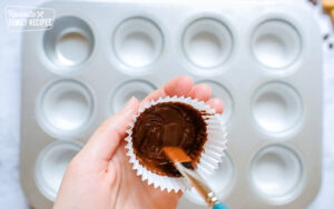 Painting Chocolate into the liners for Reeses Peanut Butter Cups