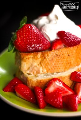 Strawberry and Cream Cheese French Toast on a plate with fresh strawberries