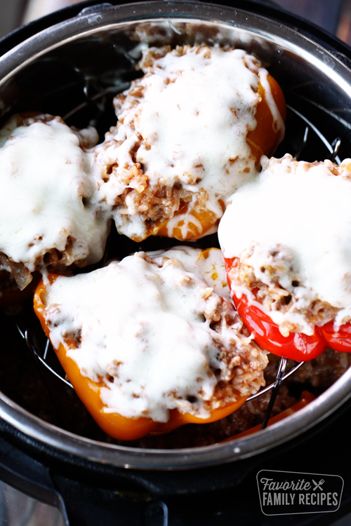 Stuffed peppers covered with melted cheese in an Instant Pot