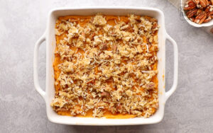Coconut pecan topping over mixed sweet potatoes