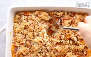 scooping up cooked sweet potato casserole to serve
