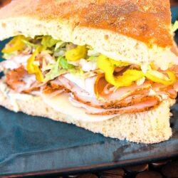 Turkey over Italy sandwich on a blue cloth napkin