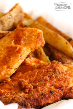 Oven Fried Chicken with steak fries on the side.